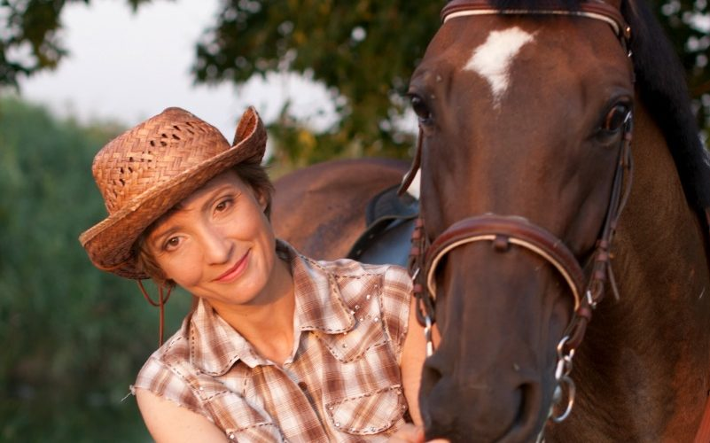 Homeschool Horse Camp - Young woman with brown horse